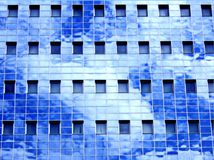 Reflection of sky in office building Royalty Free Stock Images