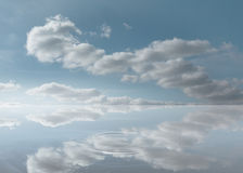 Reflection of the sky on a puddle Stock Photo