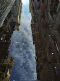 reflection of the sky on the sidewalk royalty free stock photography