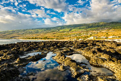Reflection of the sky on tide pools, la Reunion. Reflection of the sky on tide pools and coast of la Reunion island Royalty Free Stock Image