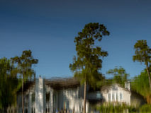 Reflection of the sky tree and building in water. Spring TX USA - March 21, 2017 - Reflection of the sky tree and building in water royalty free stock image