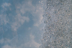 Reflection of sky on wet street Royalty Free Stock Images