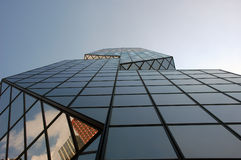 Reflection in a Skyscraper. Skyscraper with a modern Shape royalty free stock photo