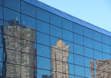 Reflection of Skyscraper in Blue Window Facade. Reflection of Urban Fragmented Skyscrapers in Blue Window Facade Stock Image