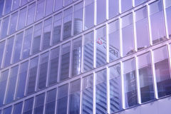 Reflection of a skyscraper in office building windows Stock Photo