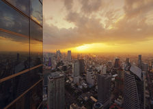 The Reflection of Skyscrapers at Sunset in Bangkok, Thailand Stock Photo