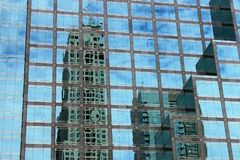 Reflection of skyscrapers in the windows of a skyscraper in Toronto royalty free stock image