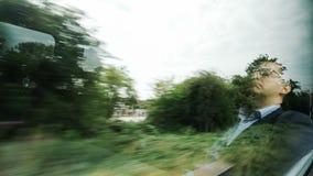 Reflection of sleeping man in window stock footage