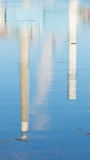 Reflection of smoke stacks on water Royalty Free Stock Image