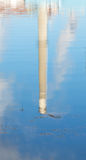 Reflection of a smokestack on salt water Royalty Free Stock Photo