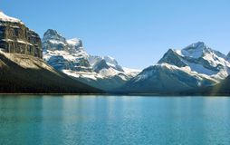 Reflection of snow capped peaks in Maligne Lake. Maligne Lake and Hall of Royalty Free Stock Photo