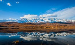 Reflection of snow peaks stock image