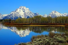 Reflection of Snowy Mount Moran from the Oxbow Bend of the Snake River at Grand Teton National Park in Wyoming stock photo
