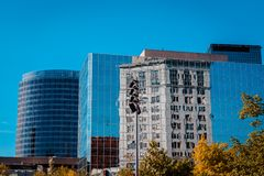Reflection of some of downtown Grand Rapid Michigan in another building. On a clear sunny day royalty free stock photography