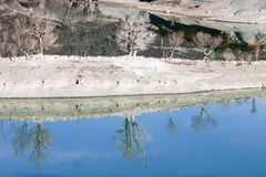 Reflection of some trees in a lake. In Huesca, Spain Stock Photo