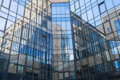 Reflection in a square glass-fronted façade. Architectural abst stock image