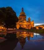 Reflection of St. Isaac& x27;s Cathedral in a puddle Stock Images