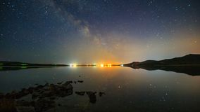 Reflection of stars in water. Timelapse 4k stock video footage