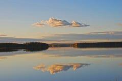Reflection on still lake stock photo
