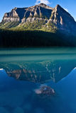 Reflection with stone. Beautiful reflection of a mountain in the water Royalty Free Stock Images