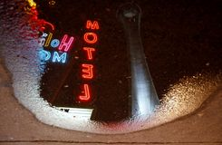 Reflection of Stratosphere Hotel, Las Vegas. Las Vegas, USA - 23 August 2016. Reflection in puddle - Stratosphere Hotel and nearby motel at night Royalty Free Stock Photos