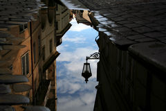 Reflection of the street lamp. In a puddle stock photo