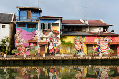 Reflection of the street and murals in the river Royalty Free Stock Image