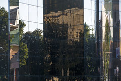 Reflection of the street in windows of modern building Stock Photo