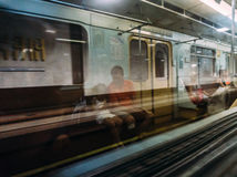 Reflection in a subway car window - people, passengers. Stock Image