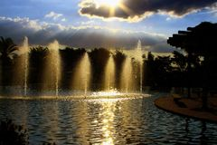 Reflection of the Sun in the artificial cascade of the park stock photography