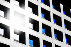 The reflection of the sun and blue sky mirrored in a modern building Royalty Free Stock Image