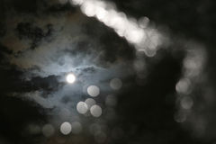Reflection of the sun and clouds in a puddle of water Stock Photography