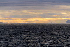 Reflection of sun at the horizon in the arctic sea Royalty Free Stock Photos