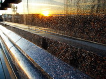 Reflection of the sun at sunset in granite Stock Photo
