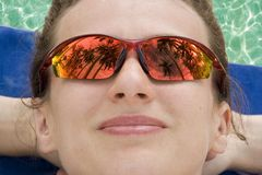 Reflection in Sunglasses. Girl on the beach Royalty Free Stock Photos