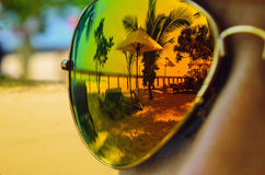 Reflection in sunglasses on the girl, beach. Royalty Free Stock Photography