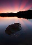 Reflection of sunrays at sunrise Stock Images