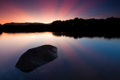 Reflection of sunrays at sunrise Stock Photography