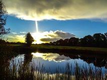 Reflection of sunrise stock photography