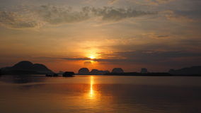 Reflection sunrise orange sky and sea at Phang nga, Thailand Stock Images