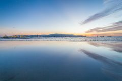 Reflection sunrise or sunset view with orange cloud and blue sky Royalty Free Stock Images
