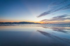 Reflection sunrise or sunset view with orange cloud and blue sky Stock Photography
