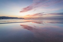 Reflection sunrise or sunset view with orange cloud and blue sky Royalty Free Stock Photo