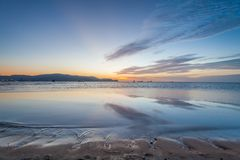 Reflection sunrise or sunset view with orange cloud and blue sky Royalty Free Stock Photography