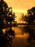 Reflection of Sunset. Reflection of golden sky on a lake in a botanical garden Stock Photo