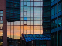 Reflection of sunset in the facade of a skyscraper, Frankfurt Stock Image