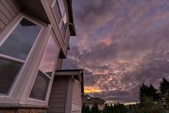 Reflection of Sunset on House Windows Stock Photos