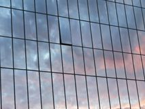 Reflection of Sunset Purple Clouds in Glass Windows of Modern Temporary Building stock photos
