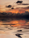 Reflection of sunset in water Royalty Free Stock Photos