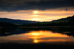 Reflection of the sunset on the water surface Royalty Free Stock Image